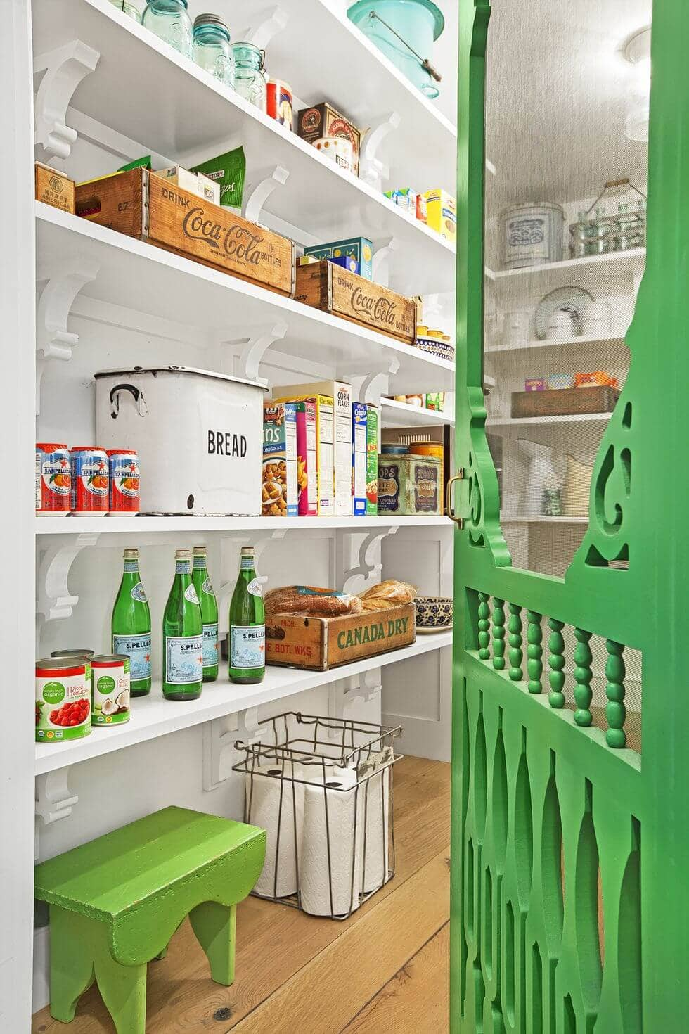 white and green pantry with screen door