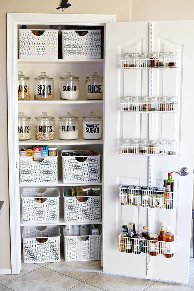 pantry with door storage, basket and jars