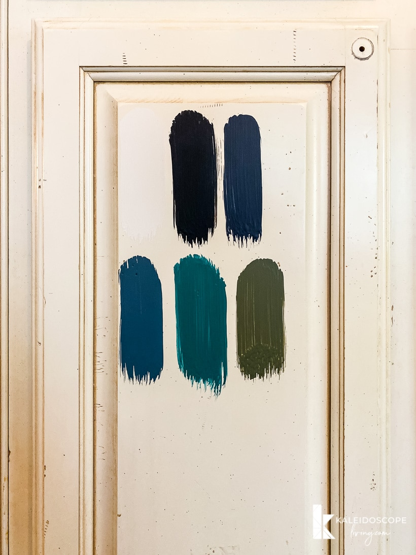 paint samples on cabinet