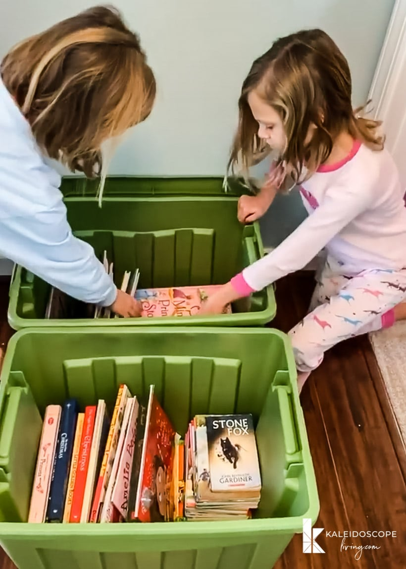 young girls sorting books