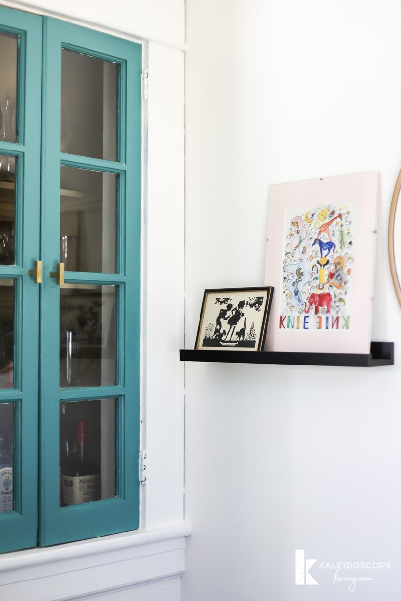 colorful art and built-in cabinet