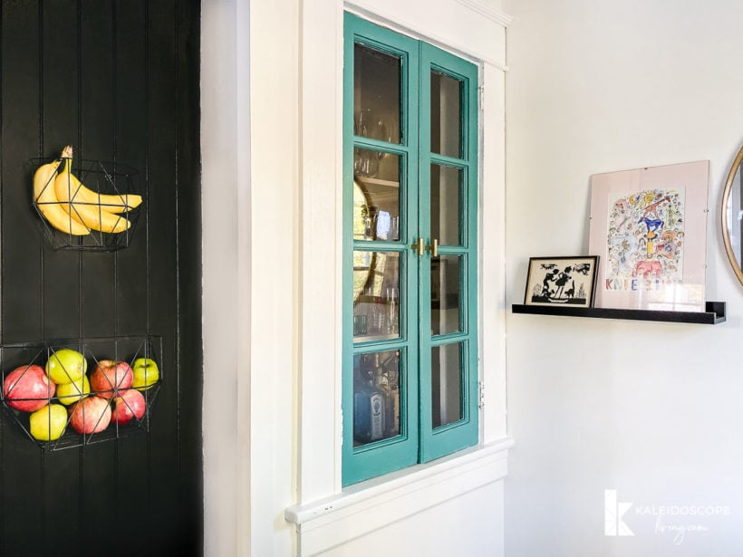 colorful cabinet and artwork in kitchen