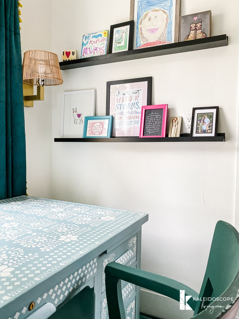 colorful art on photo ledges in office makeover reveal
