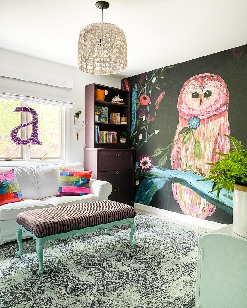 modern girl's room with mural and colorful rug