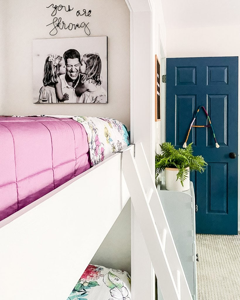 colorful bunk beds with photo canvas on wall