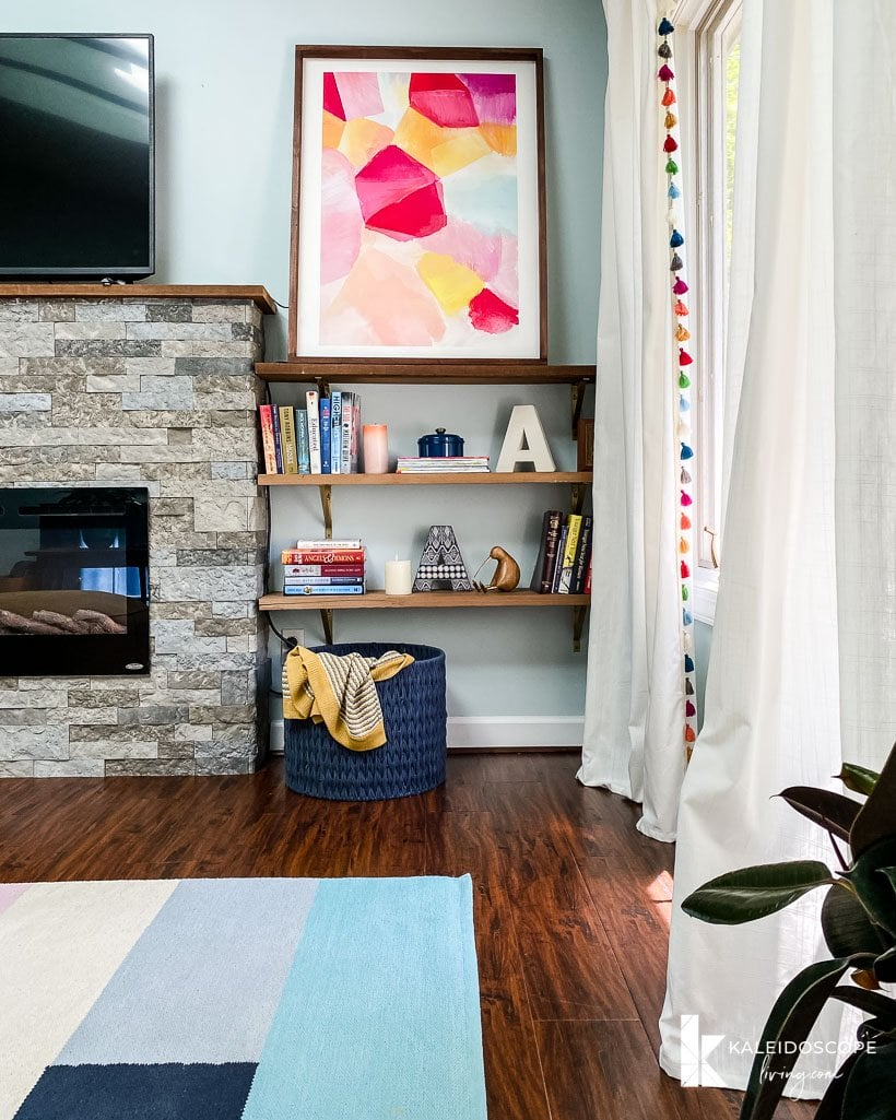 colorful art by fireplace