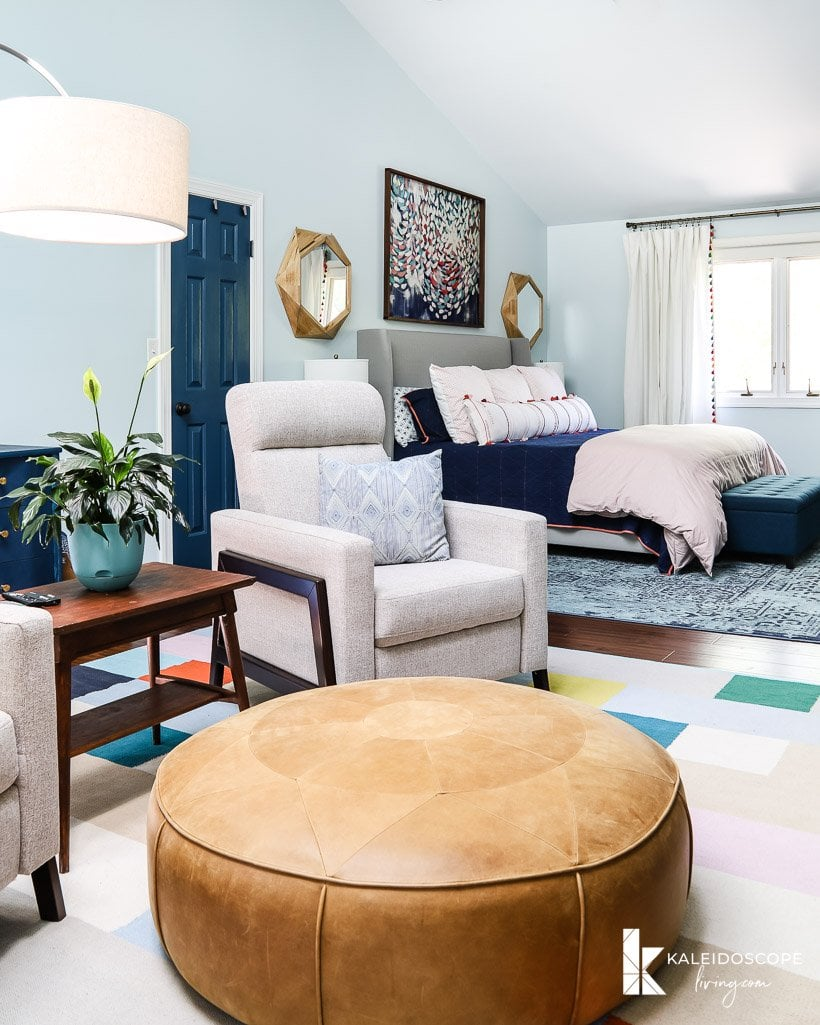 colorful master bedroom with sitting area