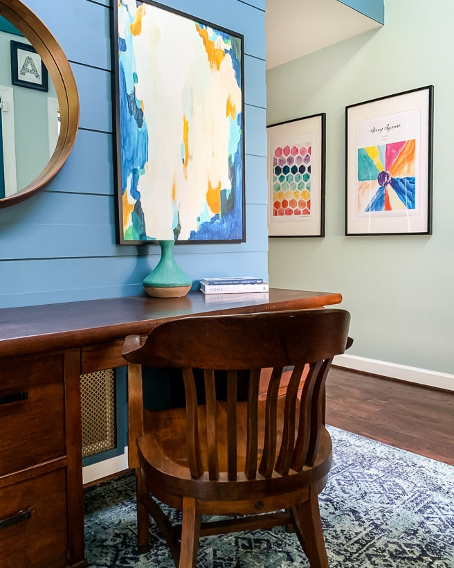foyer with colorful rug and art