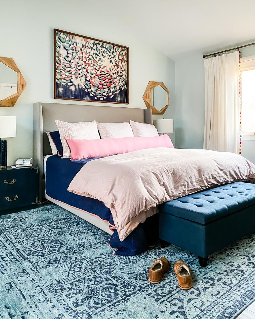 master bedroom with colorful rug