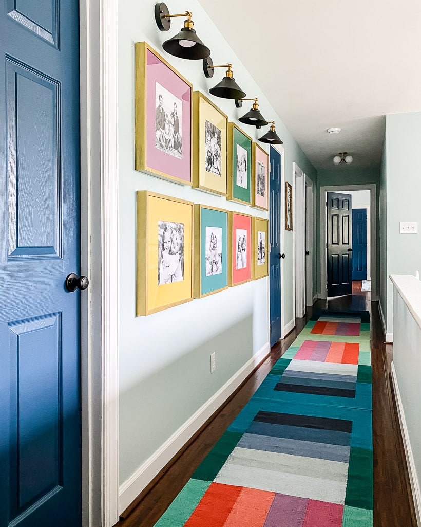 hallway with gallery wall and colorful runner