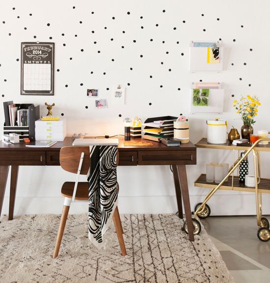 office space with fun dots and a bar cart