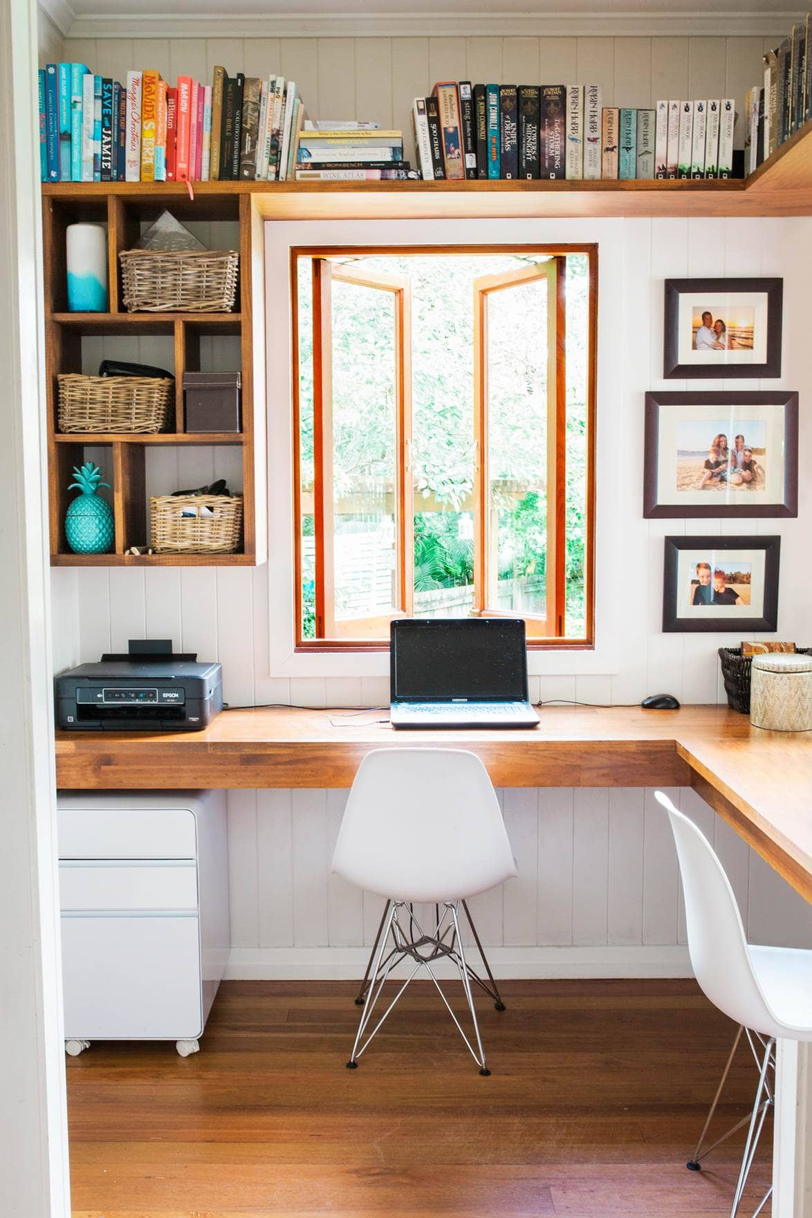 corner office with a window and shelves