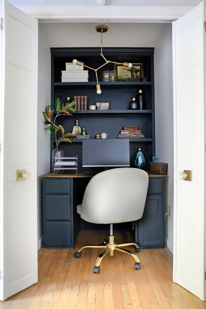office in a closet with built in shelves