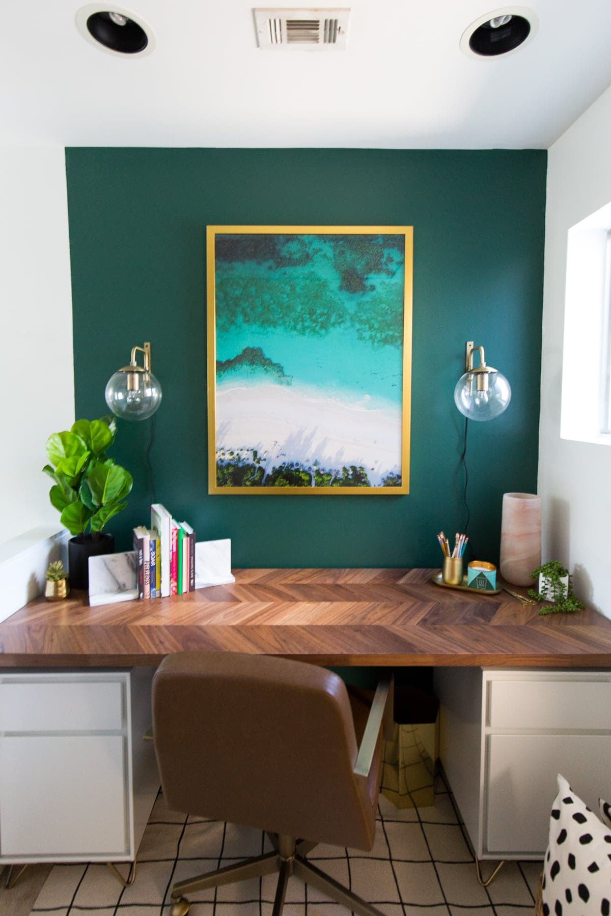 home office with bold green wall and ikea desk