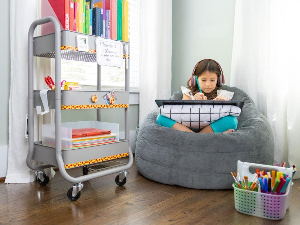 cart for school supplies and child working on bean bag chair