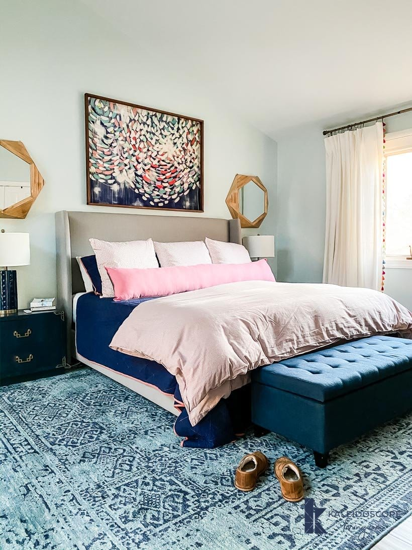 long bolster pillow in navy and pink bedroom