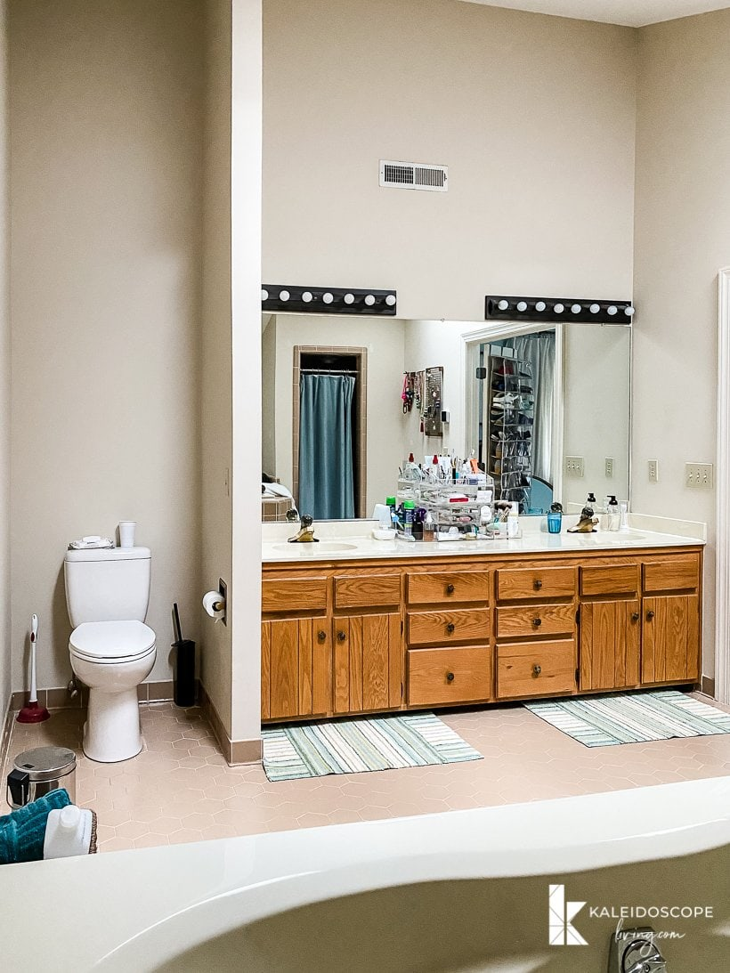 outdated bathroom with wood vanity