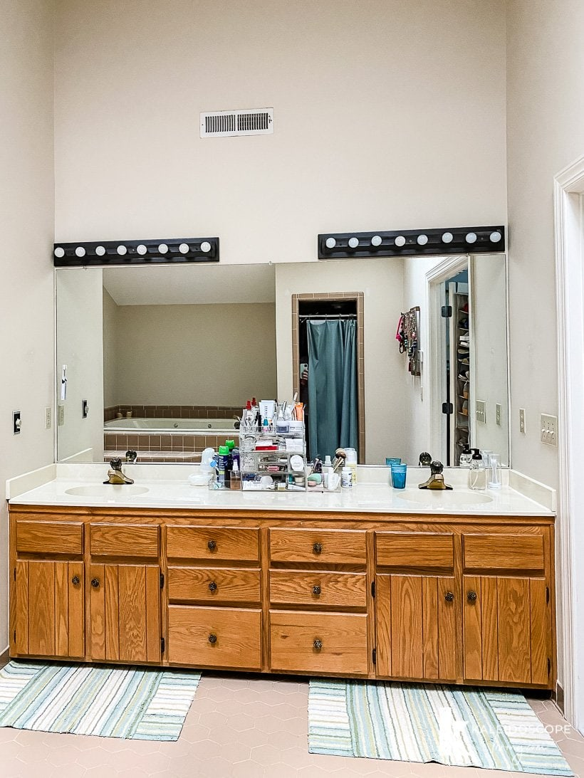 outdated wood vanity and lights