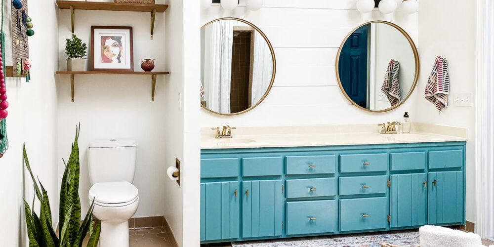 turquoise vanity with plank wall and round mirrors
