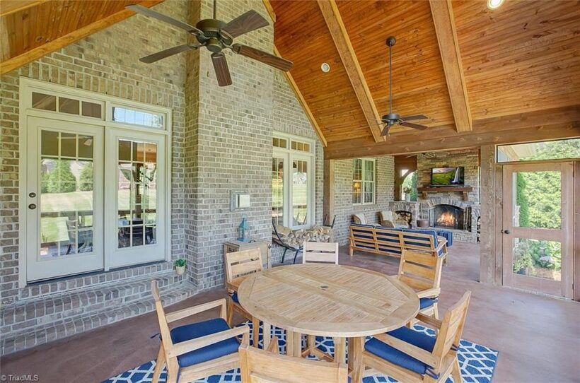 outdoor space with eating area and vaulted ceiling