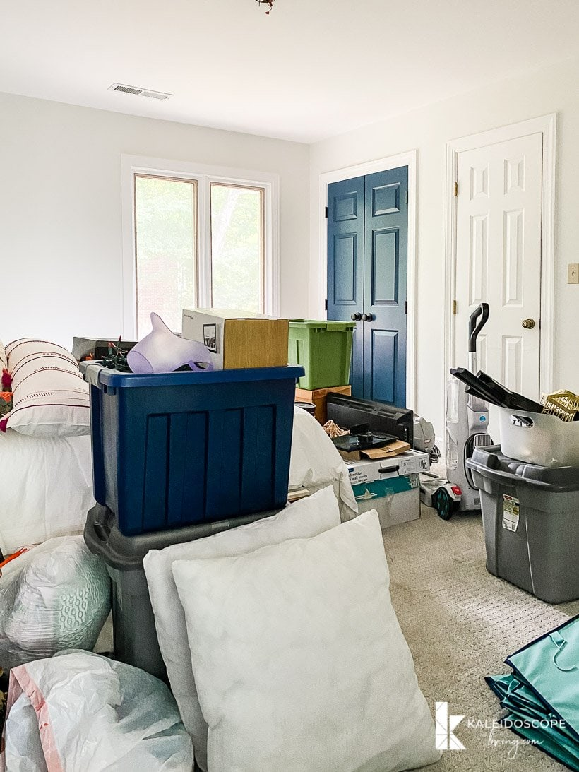 cluttered guest room before makeover