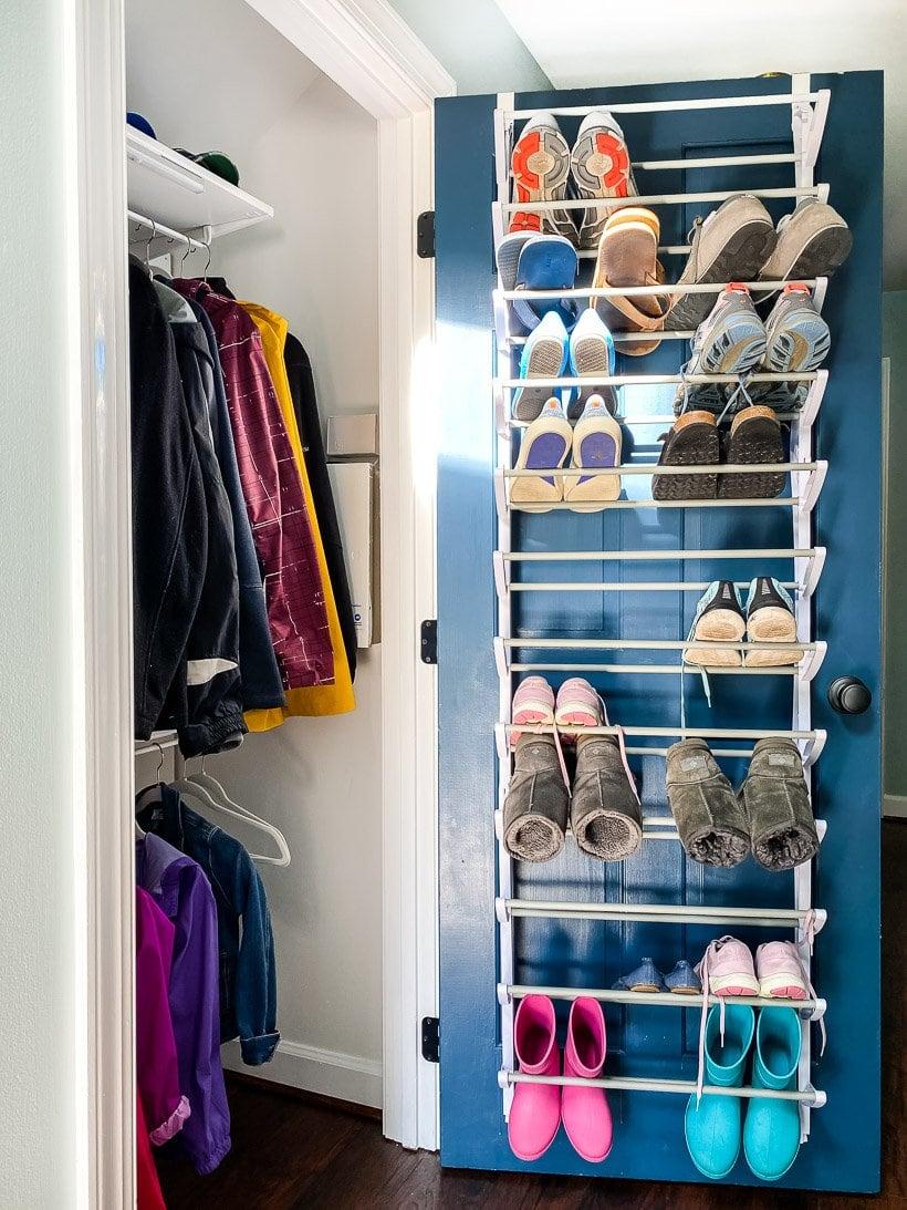 organized coat closet with shoe rack