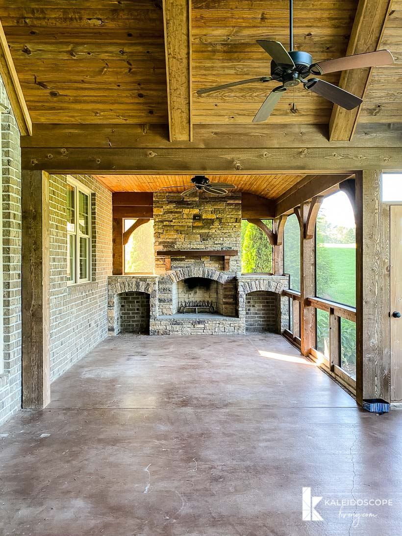 large screened in porch with fireplace