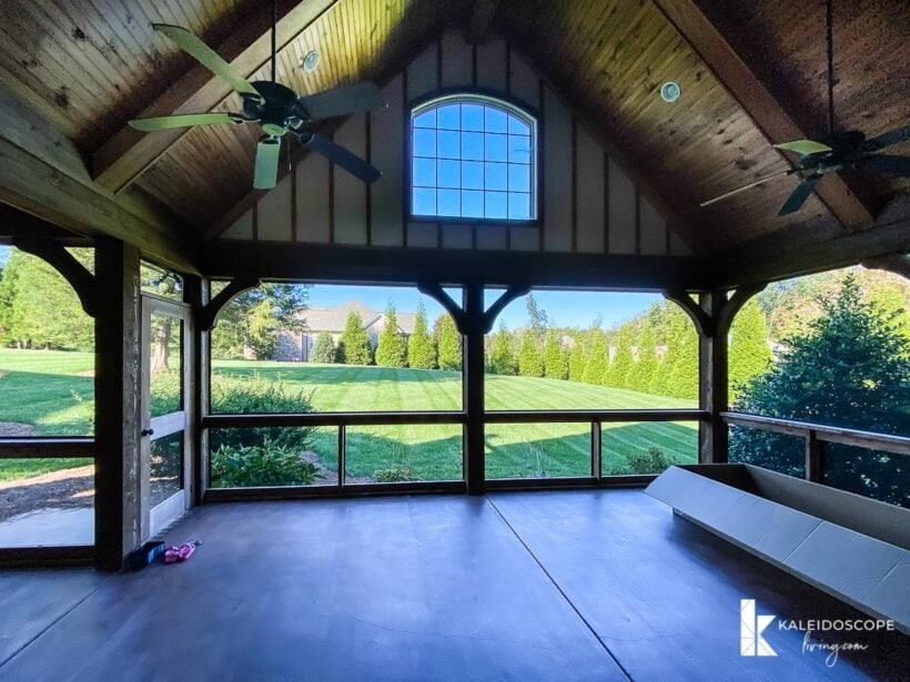 screened in porch with view of back back yard