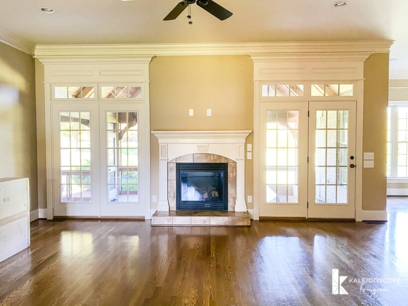 fireplace with double doors on both sides