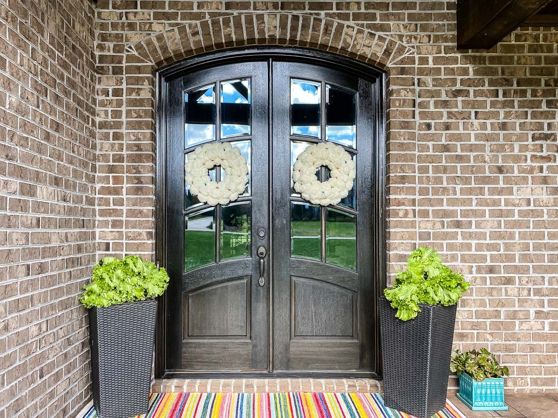 double front doors with white Christmas wreath