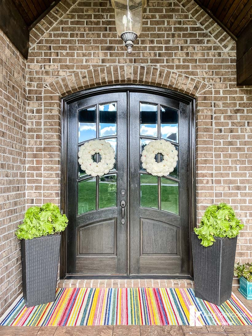 double front doors with white wreaths