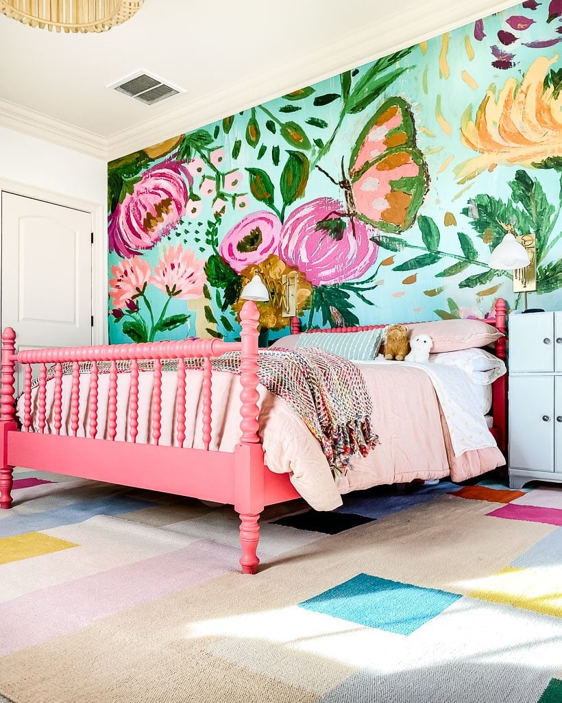 colorful girls room with flower mural
