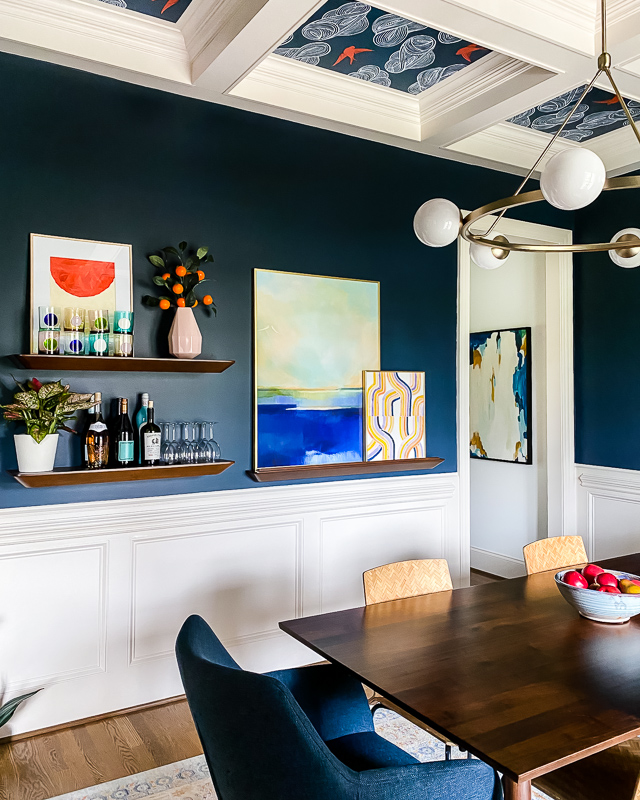 colorful art in navy dining room