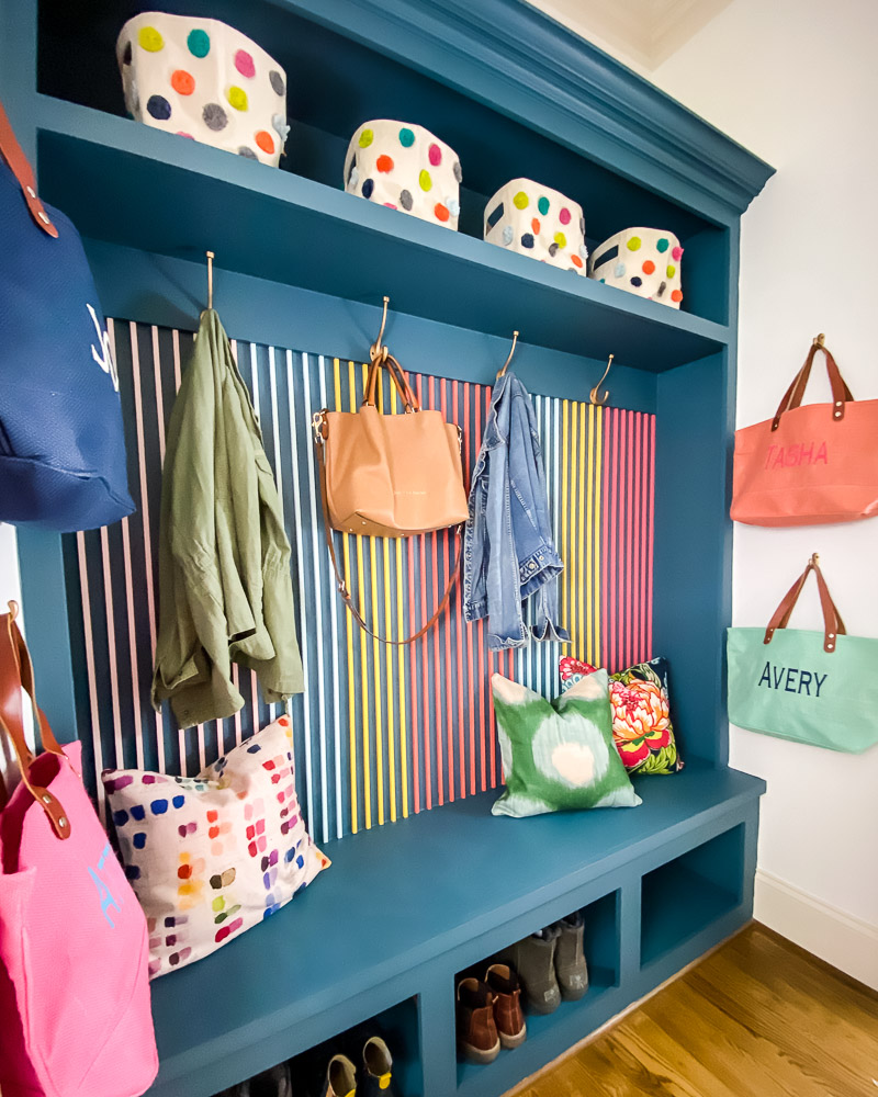 colorful mudroom with wood slat wall